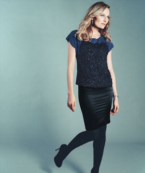 Model in Ann Taylor top and Just Cavalli skirt