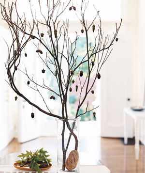 Branch with hanging acorns in a vase as a centerpiece
