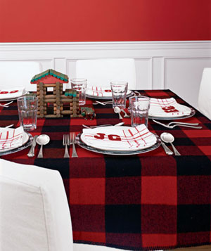 Table setting with log cabin theme, wool plaid tablecloth