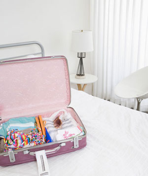 Open suitcase in white room
