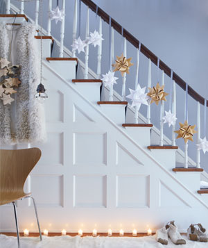 Staircase decorated with bows and candles