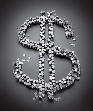 Dollar sign made out of stacks of coins
