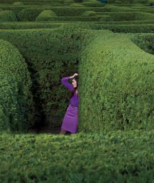 Frusterated woman standing in a maze