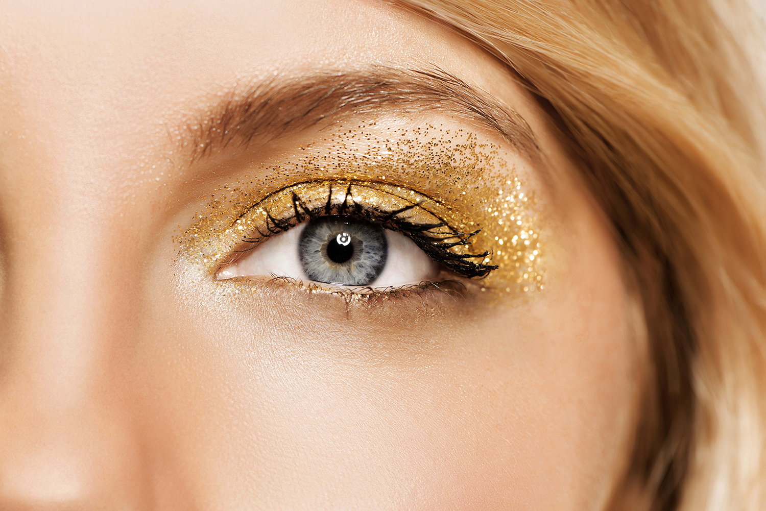 Closeup of woman wearing bright yellow eyeshadow