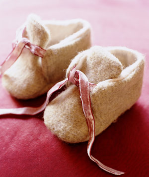 White and pink baby shoes