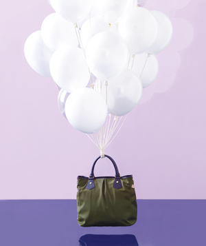 Illustration of a bag held in air by balloons