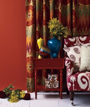 Red ikat and paisley patterned room