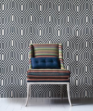 Colored zig zag striped chair with black and white wall