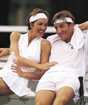 Man and woman in tennis clothing