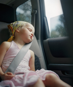 Girl asleep in backseat of car