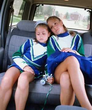 Young cheerleaders pouting
