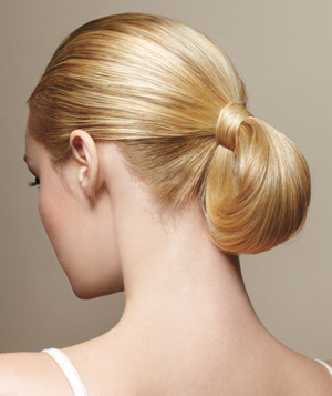 Blonde model with a pony bun