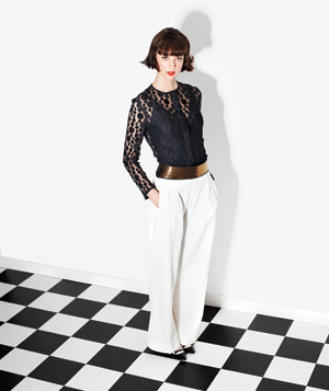 Model Wearing Black Top and White Pants