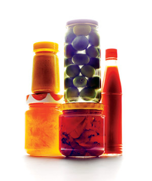 Glass jars of olives and condiments