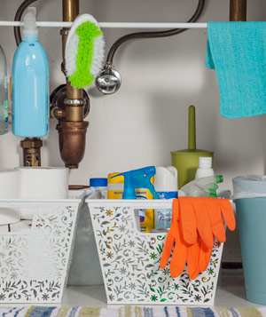 Organized bathroom cleaners under sink