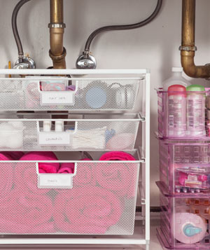 Organized cosmetics and toiletries under sink