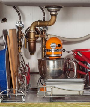 Pots, pans, and a mixer under sink