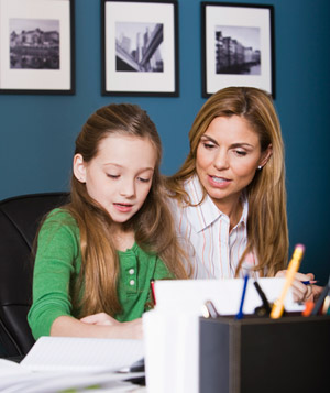 Woman with daughter at desk