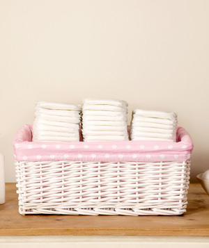 Stacks of diapers in pink basket