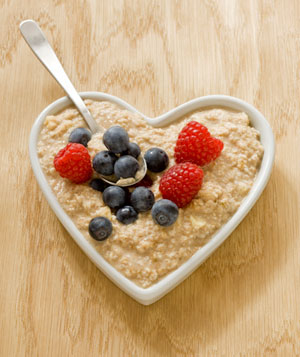 Heart shaped bowl of oatmeal with fruit
