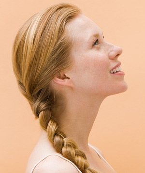 Redhead woman with braided hair
