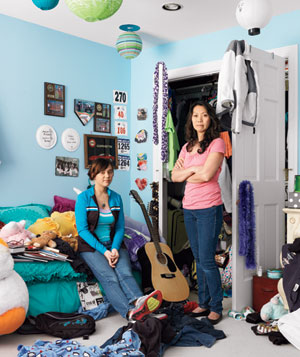 Joan and Caitie Buteau in cluttered teenager's room