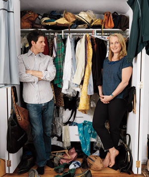 Larry Smith and Piper Kerman in front of cluttered closet