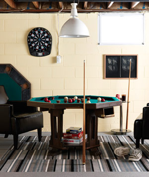 Bumper pool table and dartboard in basement