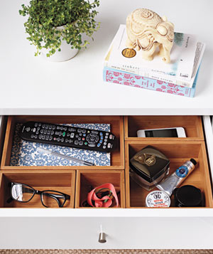 Nightstand divided by bamboo drawer organizers