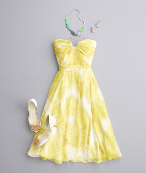 Yellow strapless dress with white and orange heels and jewelry