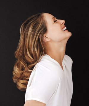 Model laughing with head tilted back