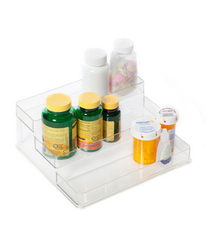 Medication bottles sitting in an acrylic case