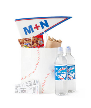 Baseball bag with bottled water, crackerjacks, and tickets