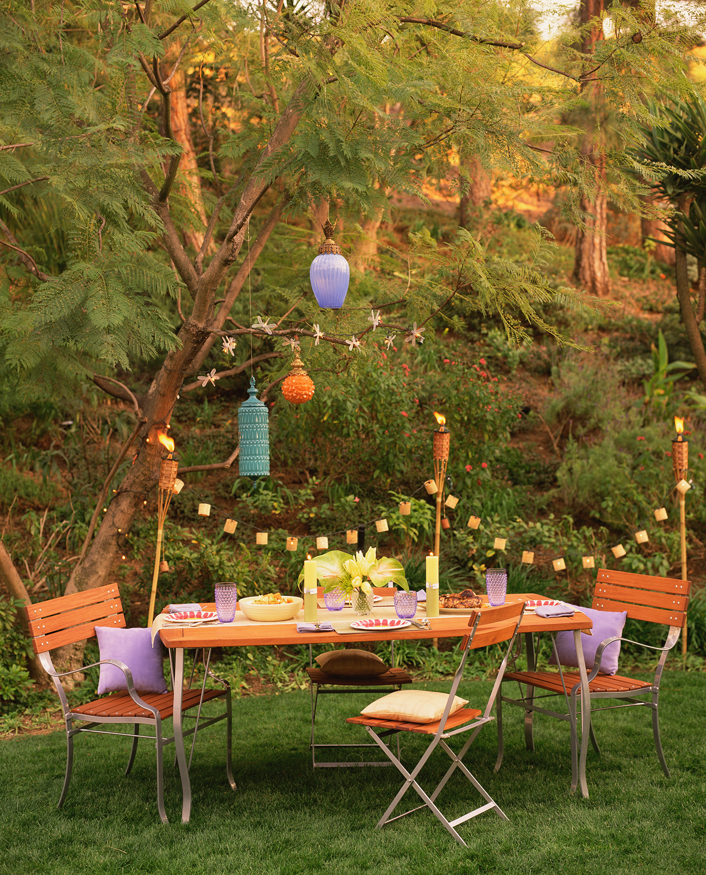 Outdoor table and chairs with hanging lights