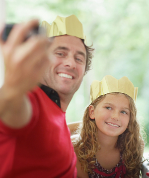 Father and daughter wearing crowns