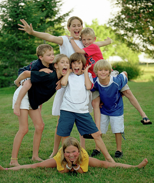 Group of kids outside laughing and cheering