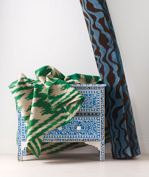 A blue chest and two rugs