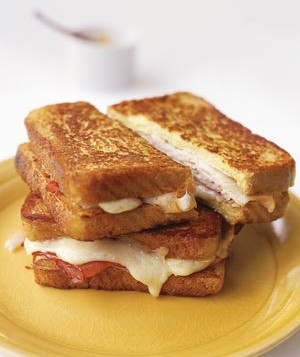 A classic Monte Cristo sandwich is batter-dipped and fried. This recipe takes time-saving liberties, starting instead with frozen French toast.