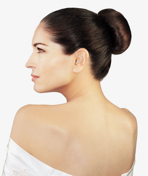 Model wearing a sock bun updo