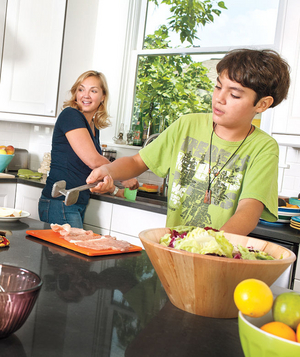 Amy Gray and her sons in their kitchen