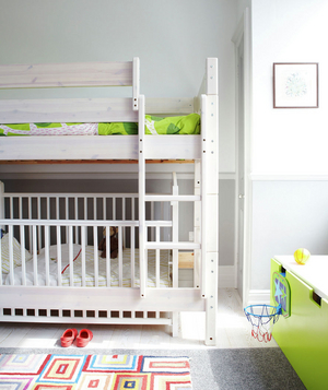 White walls and bunk beds in children's room