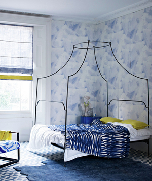Soft blue wallpapered and minimalistic bedroom