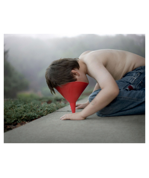 Funnel: Elijah Archibald with his face in a funnel