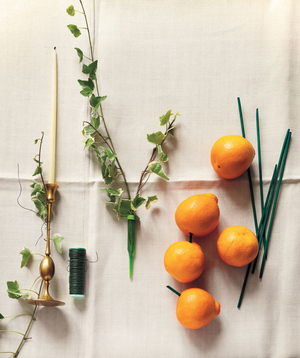 Oranges, wire, and a candle