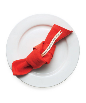 Red napkin with a note