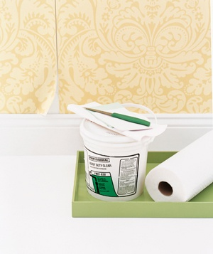 Peeling wallpaper and a bucket of wallpaper paste