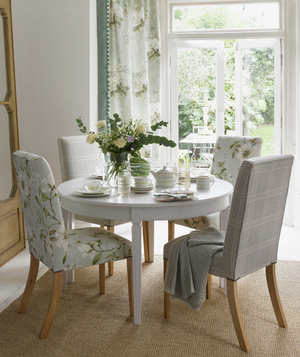 Dining room decorated with floral fabric