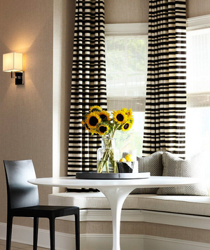 Small dining table, window seat and horizontal stripe curtains