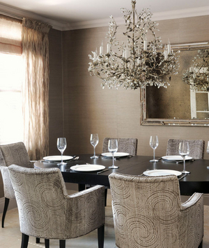 Monochromatic dining room with swirl patterned chairs