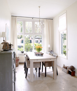 Light, open, airy dining room with a whitewashed farm table